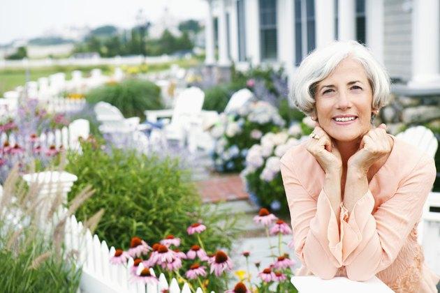 Woman in blooming garden
