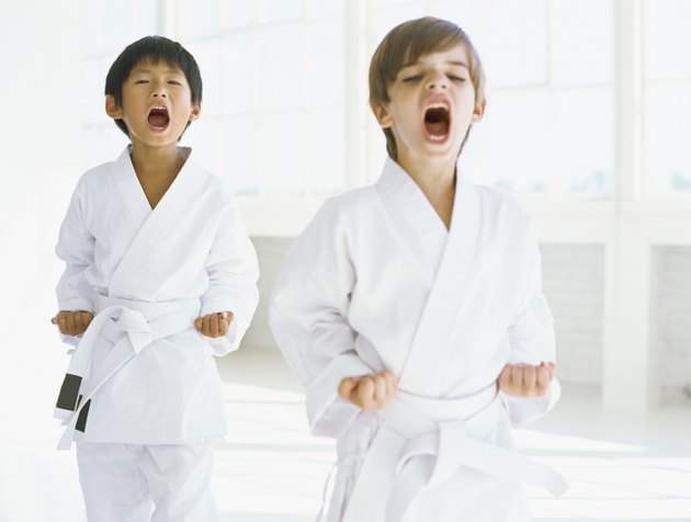 two boys practicing judo