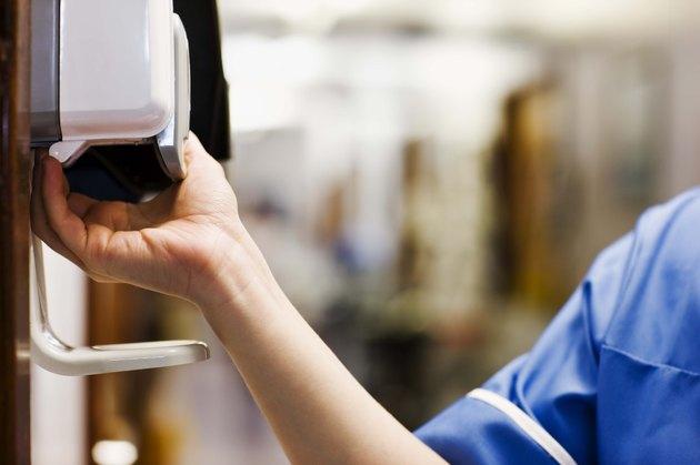 Nurse using hand sanitizer