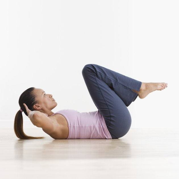 Side view of woman doing crunches