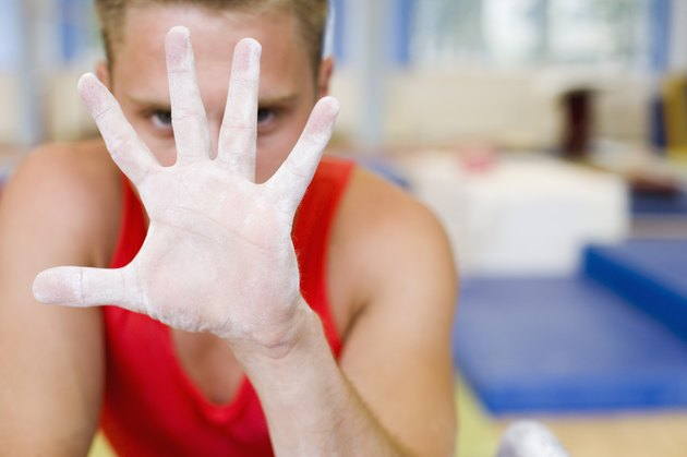 Male gymnast's chalky hand