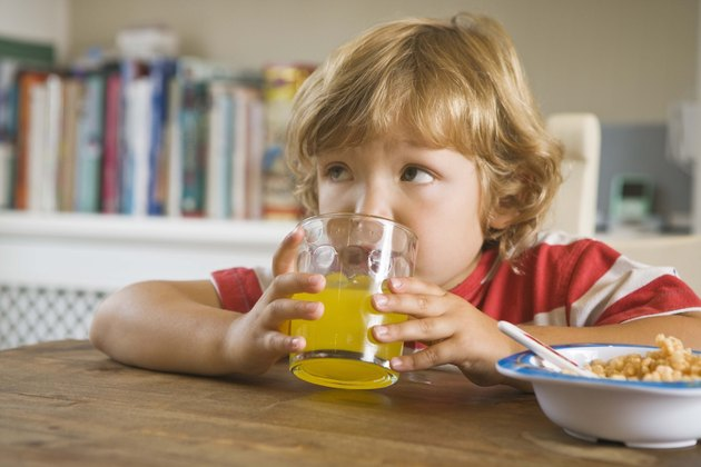 Boy drinking juice at the table