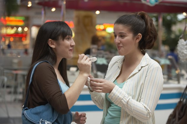 Two teenage girls looking at each other