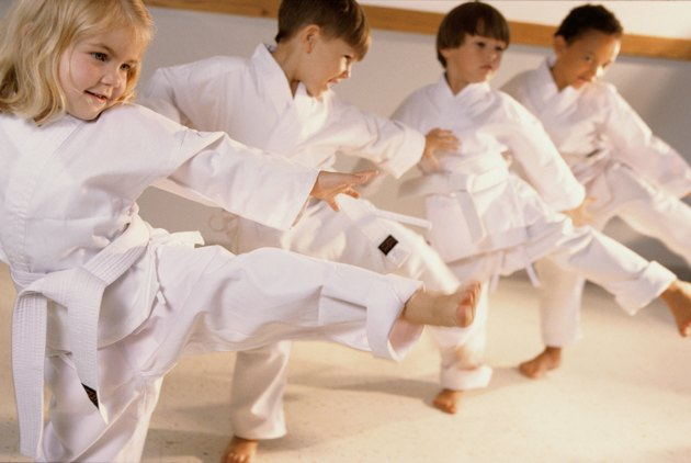 Group of children learning karate