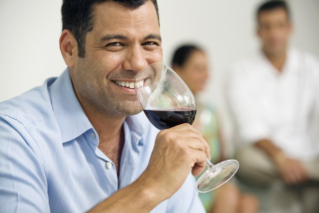 Portrait of a mature man drinking red wine