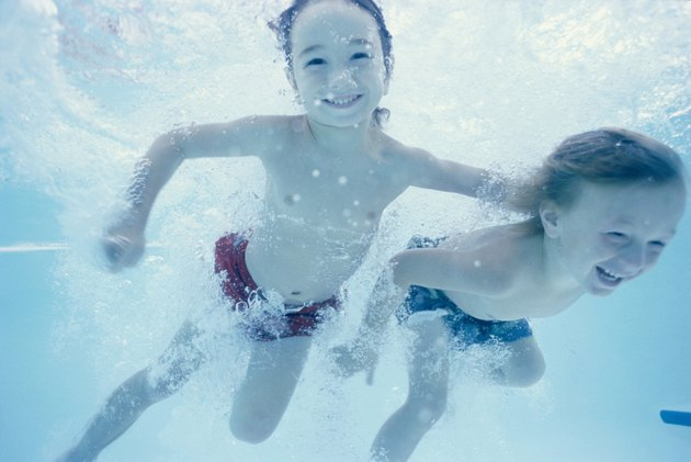 Two children swimming underwater