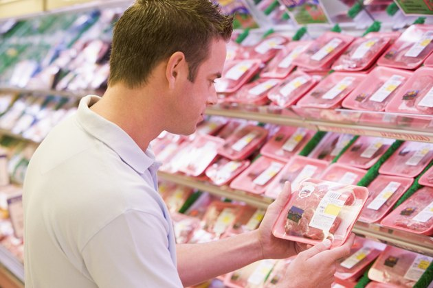 Man shopping for meat at a grocery store