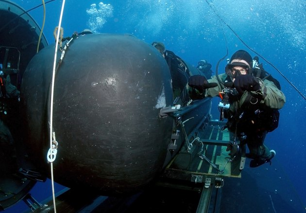 Atlantic Ocean, May 5, 2005 - A member of the SEAL Delivery Vehicle Team prepares to launch one of the team's SEAL Delivery Vehicles (SDV) from the back of the Los Angeles-class attack submarine USS Philadelphia (SSN-690) on a training exercise.