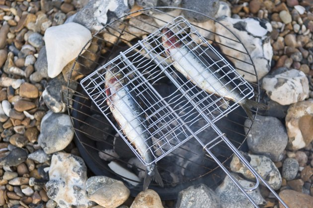Roasting fish outdoors