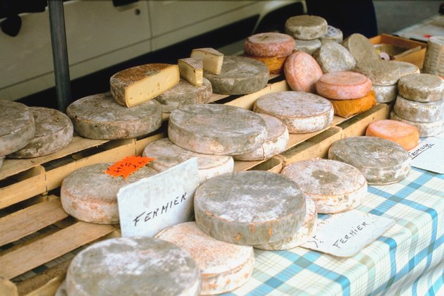 Assortment of cheese on table outdoors, Auvergne, France