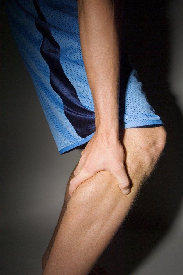 Man holding leg