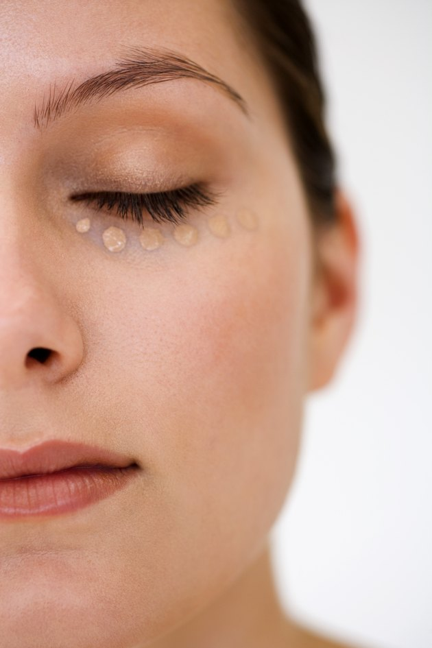Woman with makeup under eye