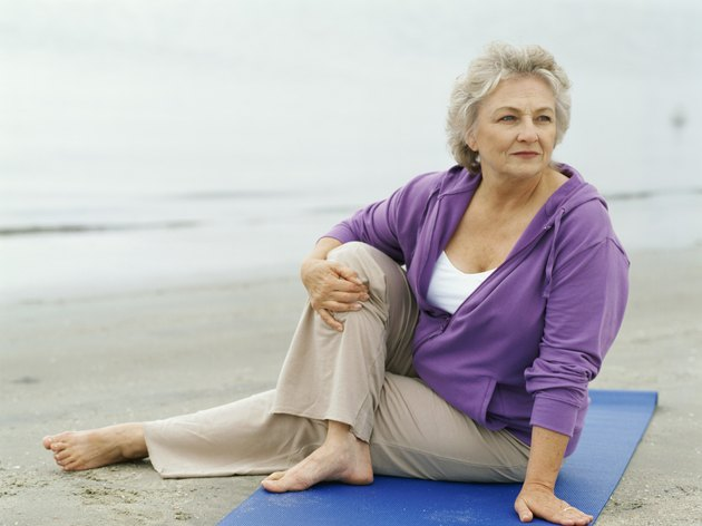 senior woman exercising on the beach