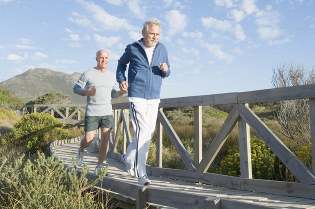 Men jogging on bridge