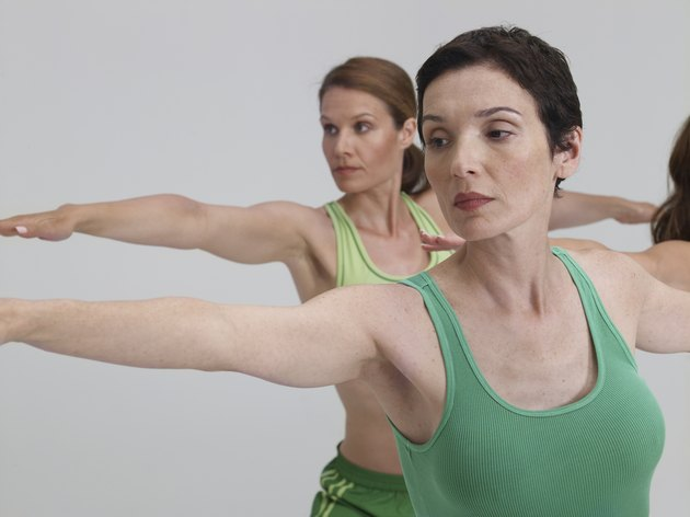 Three mature women, performing yoga