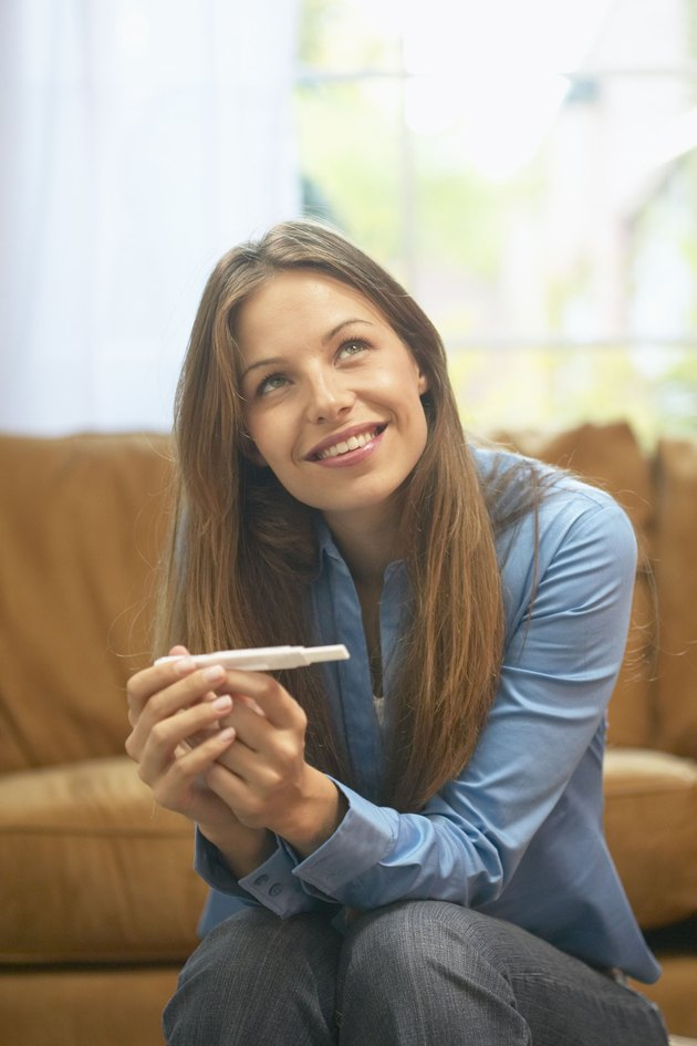 Woman holding home pregnancy test