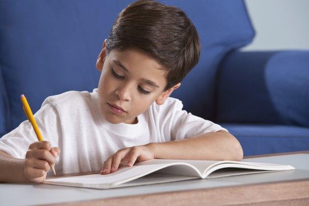 Boy studying in livingroom