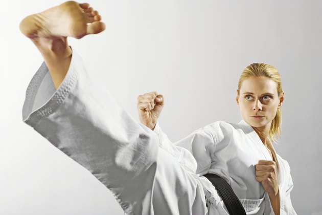 Woman performing martial arts kick