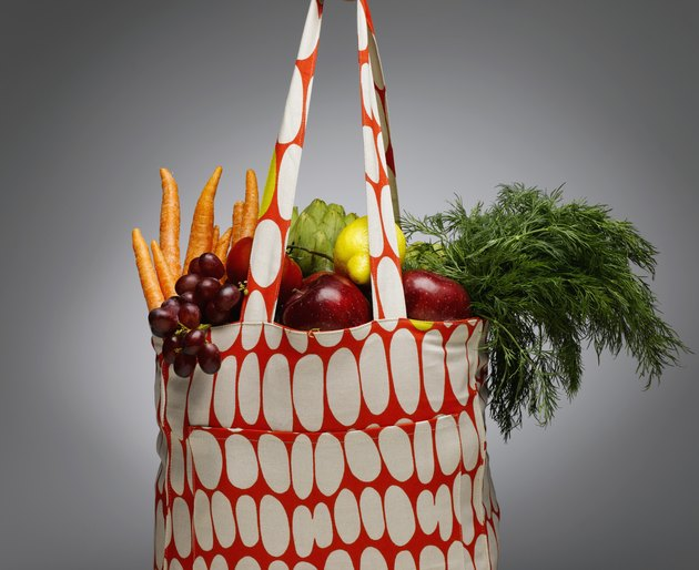 Shopping bag with fresh vegetables and fruits, close-up