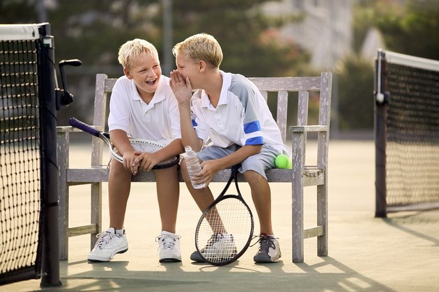 Boys with tennis rackets