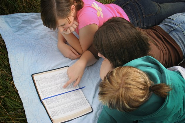 Teenagers studying the bible
