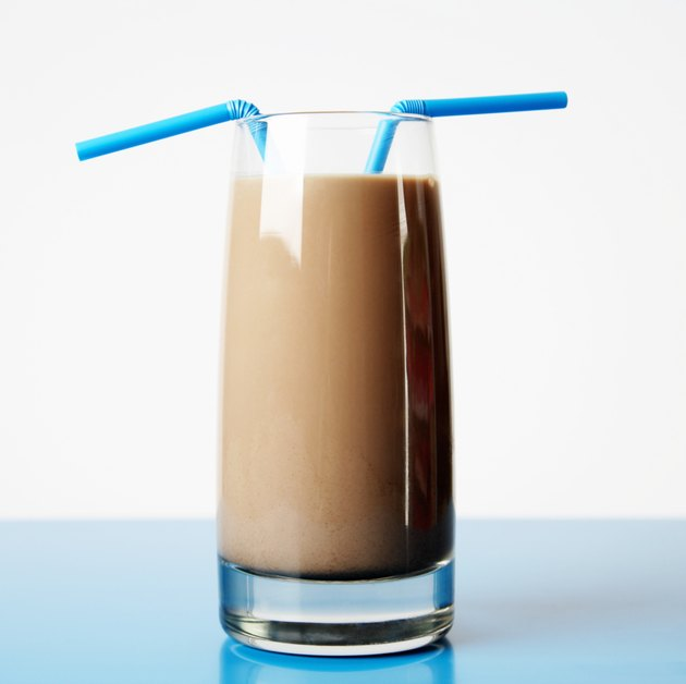 Glass of Chocolate Milk with Two Straws