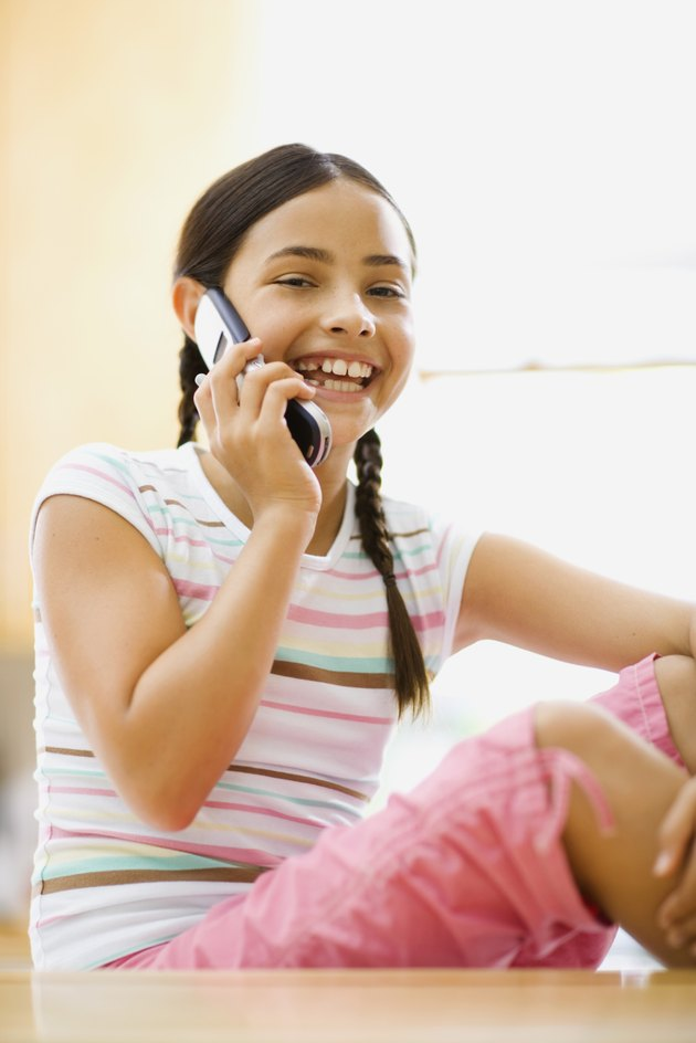 Pre-teen girl talking on cell phone