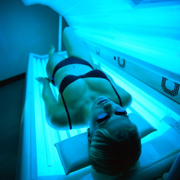 high angle view of a woman lying in a tanning machine