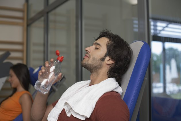Man drinking water after exercising