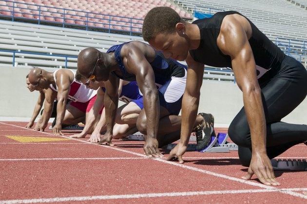 Male sprinters in starting blocks