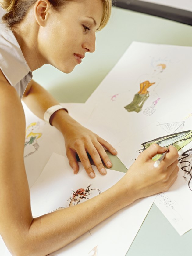 Side profile of a fashion designer sketching