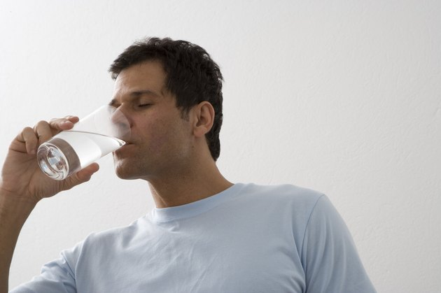 Mature man drinking water