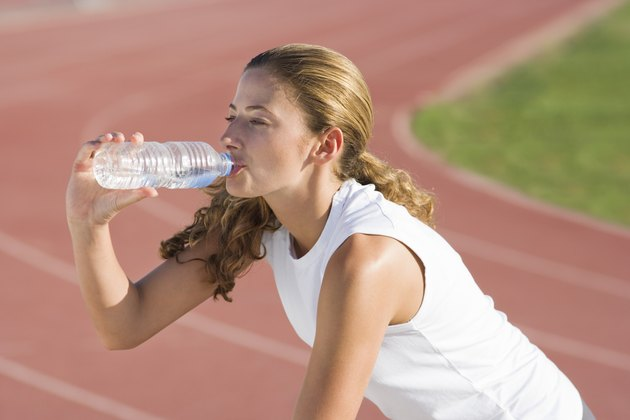 Runner drinking water