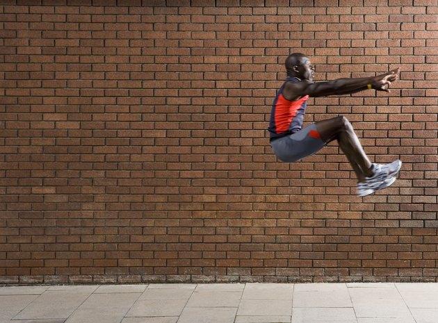 Athlete Performing Long Jump