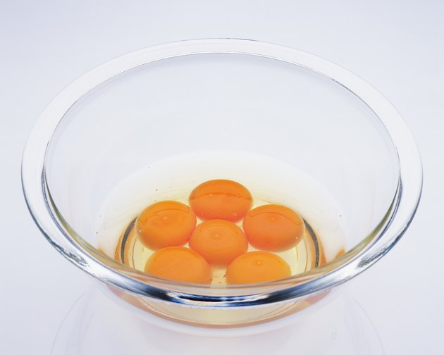 Six Raw Eggs in the Glass Bowl, High Angle View