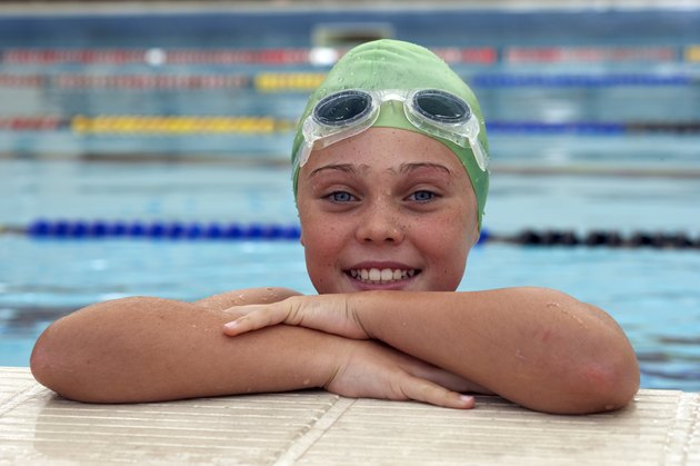 young female swimmer in swimming poo