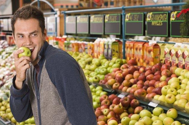 Sneaky man eating an apple