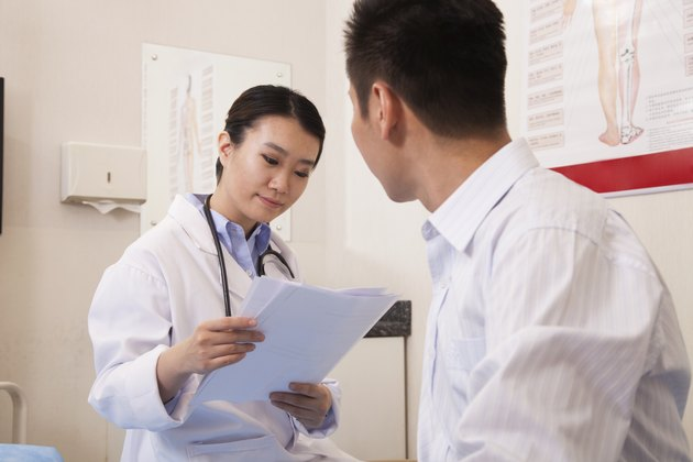 Female Doctor With Male Patient