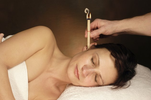 woman with ear candle therapy