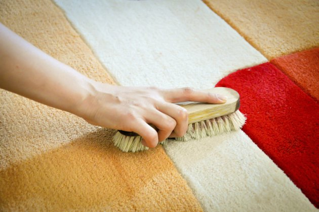 woman cleaning carpet from stain
