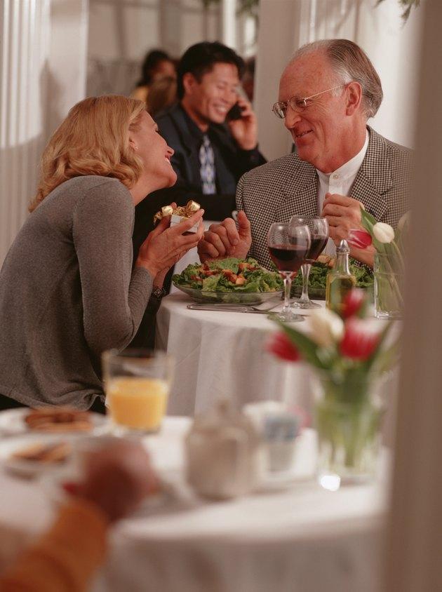 Mature couple sitting in restaurant, talking