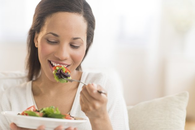 Woman Eating Fresh Salad At Home