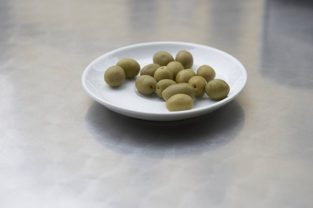High angle view of olives on a plate