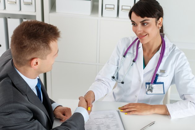 Beautiful smiling female medicine doctor shaking hands with male
