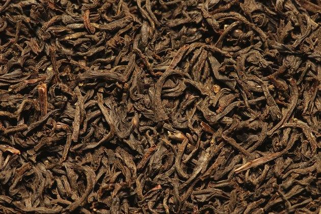 Orange pekoe black tea background