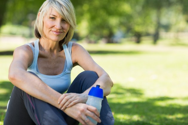 Woman with water bottle in park