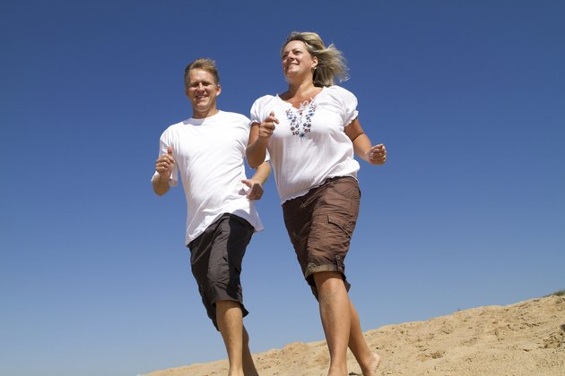 active middle aged couple running