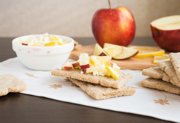 Healthy breakfast. Fresh healthy snack. Fruit salad with crispbread.