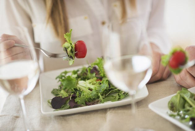 USA, New Jersey, Jersey City, Midsection of woman eating salad