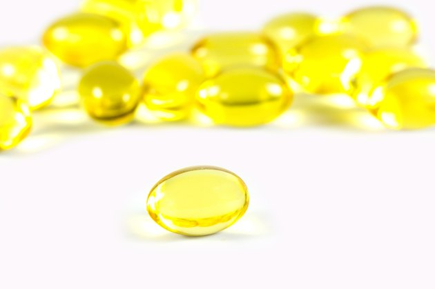 Rice bran oil pills on white background